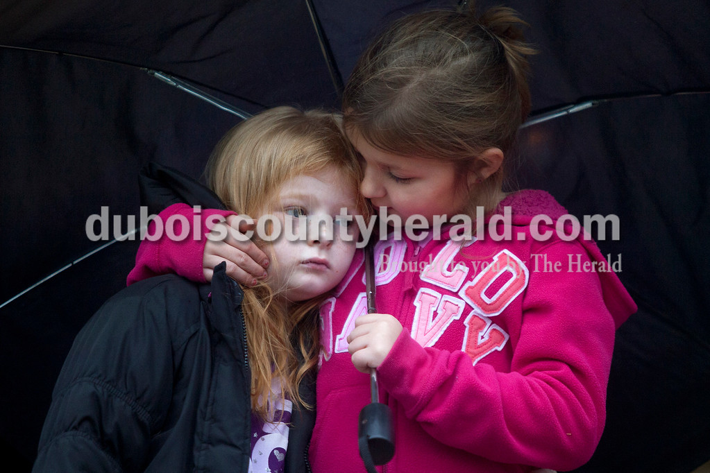 """Emma Mitchell of Dubois, 6, right, comforted her cousin Grace Kluesner of Dubois, 4, during a memorial service Sunday at Dubois County Park for families who have experienced the death of a child. Our Precious Angels of Dubois County organized the ceremony so families could remember their loved ones. Grace and Emma and their family remembered their cousin Benton Kluesner and uncle Terry Kluesner. """"Benton always gave us freezie pops,"""" Emma remembered. Olivia Corya/The Herald"""