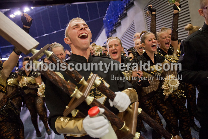 Forest Park drum major Travis Vonderheide, a junior, shouted as he carried the Rangers' first-place trophy and led the marching band and color guard off the field after winning the Class D championship.  Rachel Mummey/The Herald