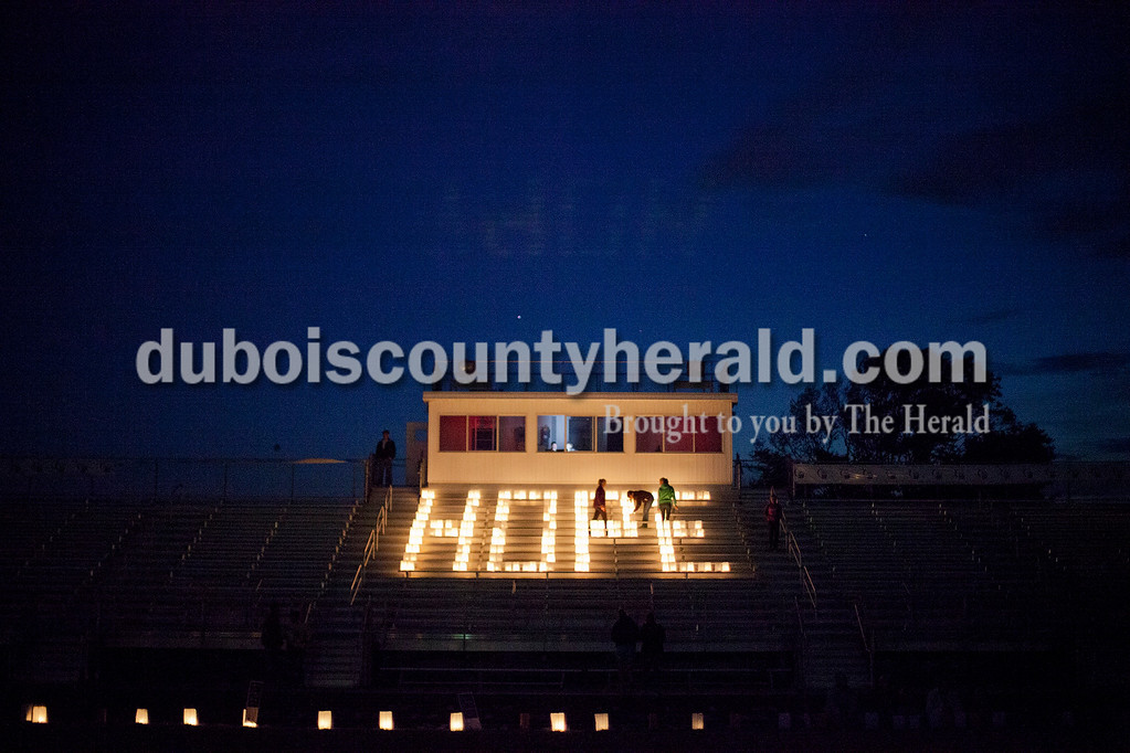 """The word """"Hope"""" was spelled out in candles during the luminaria ceremony of the Relay for Life of Dubois County at Jasper Middle School on Friday evening. Balloons and candles were illuminated in honor of loved ones who have died of cancer and those who are surviving or still battling the disease.  Rachel Mummey/The Herald"""