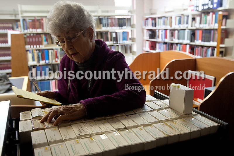 Dave Weatherwax/The Herald<br /> Helen Zuber Keusch of Huntingburg thumbed through a drawer of microfilm in the genealogy room at the Jasper Public Library on Wednesday morning. Keusch said she appreciated how much more was added to the room during the month-long renovation, but noted that there was so much more the library had in it's possession that still was not out on the shelves due to a lack of space.