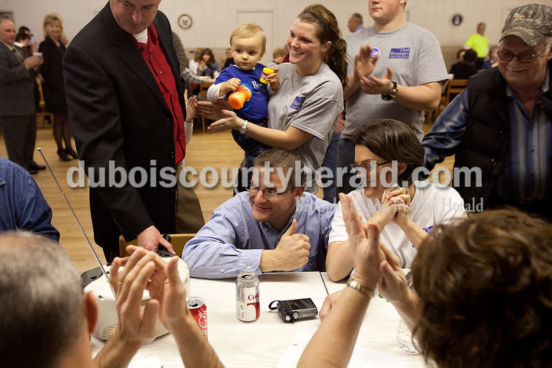 Surrounded by family and supporters, Chad Blessinger of Jasper, middle, gave a thumbs up as favorable results in his race to retain his job as Dubois County treasurer were announced over the radio at Veterans of Foreign Wars Post 673 in Jasper. Blessinger, a Republican, defeated Democratic challenger Paul Voegerl Sr. Democratic candidates gathered at the Knights of Columbus Hall in Jasper to await election results. Dave Weatherwax/The Herald