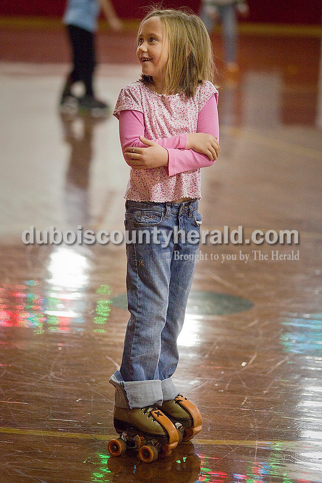 Rachel Mummey/The Herald<br /> Jillian Miller of Jasper, 6, wrapped her arms around herself as she steadied her balance at the Skate Palace in Jasper on New Year's Eve. Jillian went skating during the rink's extra holiday hours with her sister Marina Morgan, of Carlyle, 10.