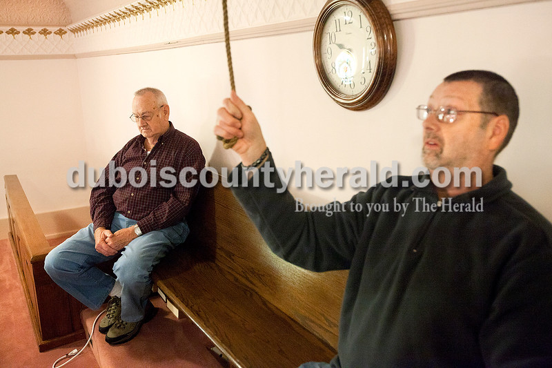 """Dave Weatherwax/The Herald<br /> Wayne Satkamp, left, joined his son, Charley, in the balcony of St. Paul United Church of Christ this morning as Charley tolled the church bell 26 times, once for each of the 20 children and six adults killed by a gunman at Sandy Hook Elementary School in Newtown, Conn., one week ago. Several Dubois County churches joined in the tolling at 9:30 a.m. to honor the victims at the same time a moment of silence was being observed in Newtown at the declaration by Connecticut Gov. Dannel Malloy that today be a statewide """"Day of Mourning."""""""
