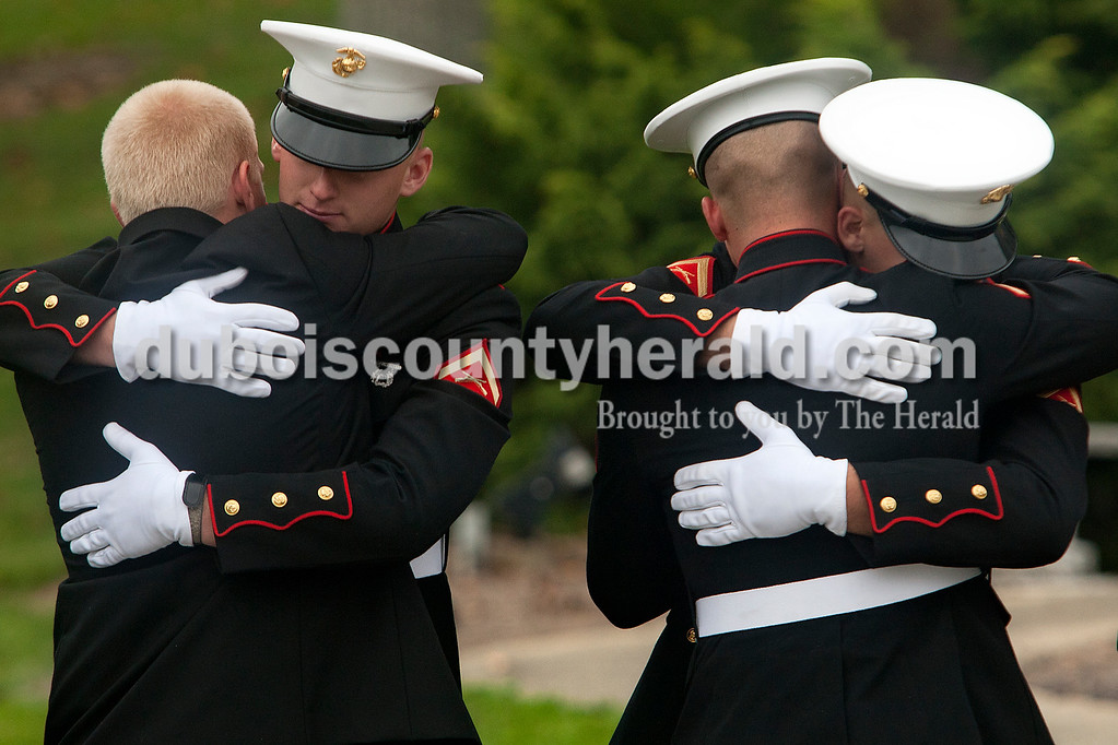 High school friends of Lance Cpl. Alec Terwiske, including Logan Ingle, left, Lance Cpl. Tyler Lampert, Lance Cpl. Ben Knies and Lance Cpl. Corey Freyberger shared hugs following Terwiske's funeral on Friday at St. Celestine Catholic Church. Dave Weatherwax/The Herald