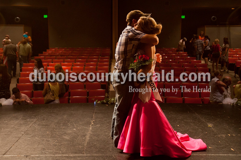 Tori Hedinger of Birdseye, 17, received a hug from her boyfriend, Jacob Lauer of Richland after winning the 2012 Miss Heimatfest Queen Pageant and Miss Photogenic at Forest Park High School in Ferdinand on Sunday evening. Jenna Bieker of Ferdinand, 16, was the runner up, Alexa Lange of Ferdinand was Miss Congeniality, Brianne Perry of Ferdinand, 8, was Little Miss Heimatfest, and Ethan Hassfurther of Ferdiand, 8, was Little Mister Heimatfest.  Rachel Mummey/The Herald