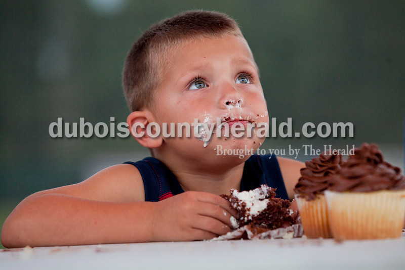 Justin Leathers of Huntingburg, 4, came up for air while competing in the cupcake eating contest at the Herbstfest in Huntingburg on Thursday. Although he didn't win, he put forth a valiant effort and earned the nickname Mighty Fly from the judges.  Rachel Mummey/The Herald