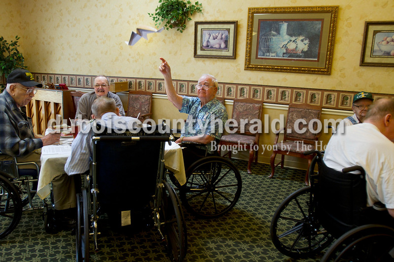 St. Charles Health Campus resident Lilburn Berry took aim with a paper airplane in the dining room of the Jasper nursing center before lunch Thursday. The center's residents do a pre-meal activity each day, and Thursday's entertainment was inspired by the upcoming anniversary of Orville Wright's birth. Wright was born Aug. 19, 1871. Olivia Corya/The Herald