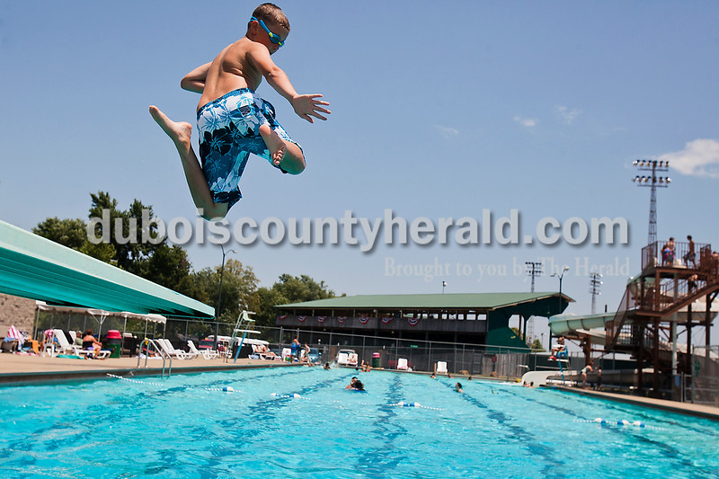 Carson Mundy of Huntingburg, 11, leapt off the diving board at the city pool Thursday afternoon. The National Weather Service has issued an excessive heat watch through Indiana with heat indexes ranging from 105 to 110 degrees. Employees at both the Huntingburg and Jasper pools said extreme heat inhibits people from using the pools and they opt to stay inside instead. Rachel Mummey/The Herald
