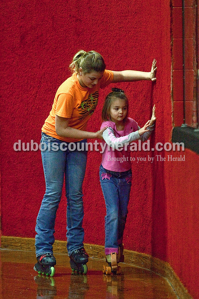 Rachel Mummey/The Herald<br /> Raylnn Vaal of St. Meinrad, 12, held onto her cousin Molly Scherzer of Lamar, 6, at the Skate Palace in Jasper on New Year's Eve. The girls were there to take advantage of the rink's extra holiday hours.