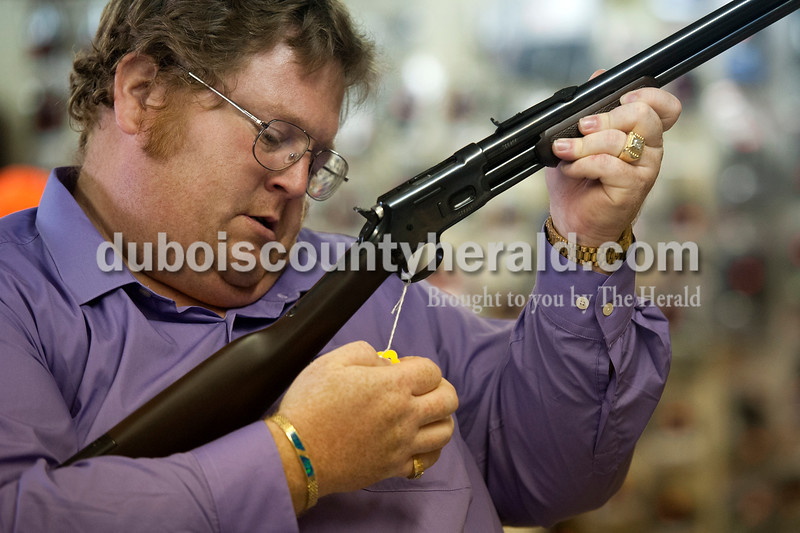 Olivia Corya/The Herald<br /> Andrew Bennington of Washington checked the price on a rifle at Jeff's Bait & Guns in Jasper on Wednesday. Bennington is a gun collector and a frequent customer at the store. Local gun vendors have enjoyed a recent boost in sales. They attribute the uptick partly to the reelection of President Obama, whom many customers expect to tighten gun control legislation. This trend likely owes more to current gun owners purchasing additional firearms than it does to an increase in first time buyers; according to the General Social Survey conducted by the University of Chicago, the percentage of gun owning Americans has steadily declined for three decades.