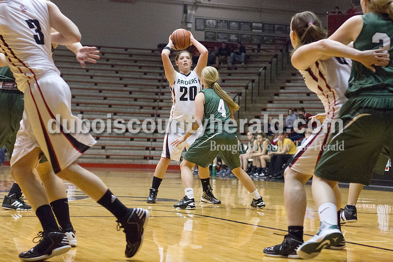 Rachel Mummey/The Herald<br /> Southridge's Kendyl Dearing searched for an open pass while being guarded by Forest Park's Amanda Jacob during Monday night's game at Memorial Gym in Huntingburg. Southridge won 46-42.