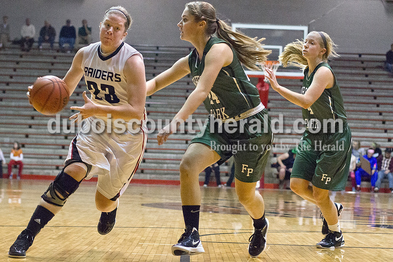 Rachel Mummey/The Herald<br /> Southridge's Victoria Schaefer drove the ball past Forest Park's Libby Gress and Amanda Jacob during Monday night's game at Memorial Gym in Huntingburg. Southridge won 46-42.