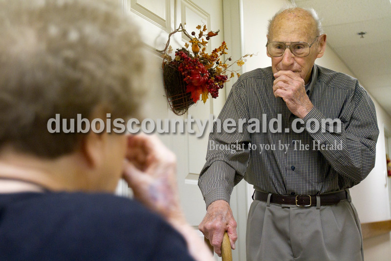 Olivia Corya/The Herald<br /> Brookside Village Senior Living Community resident Charles Bohnert reacted as he ran into his wife Helen Bohnert, also a Brookside resident, who had just received a complementary makeover in celebration of the couple's 65th wedding anniversary on Sunday morning. Later that day, friends and family came for a special open house in honor of the occasion. Helen said the star treatment made her feel very special.