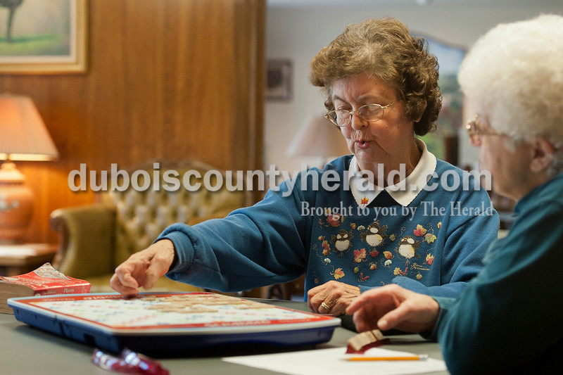Olivia Corya/The Herald<br /> Betty Schmitt, left, and Cathy Buechlein, both of Jasper, played scrabble at the Older Americans Center at the Arnold F. Habig Community Center in Jasper on Tuesday afternoon. They met through the center's biweekly scrabble tournament about two years ago, and have been playing with each other and three other regulars ever since.