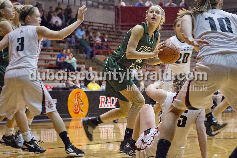 Rachel Mummey/The Herald<br /> Forest Park's Lydia Lange pivoted toward the basket for a shot during Monday night's game against Southridge at Memorial Gym in Huntingburg. Southridge won 46-42.