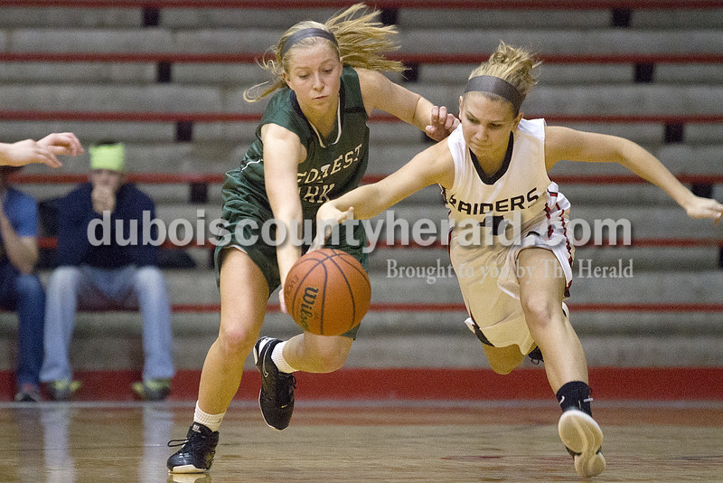 Rachel Mummey/The Herald<br /> Forest Park's Amanda Jacob and Southridge's KaylaVoegrel raced for possession of the basketball during Monday night's game at Memorial Gym in Huntingburg. Southridge won 46-42.