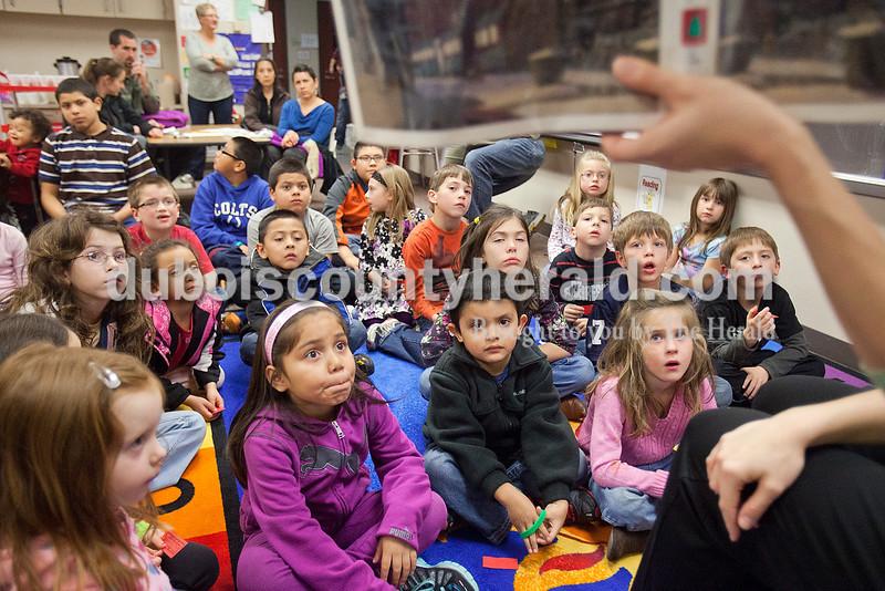 Rachel Mummey/The Herald<br /> Area school children gathered to listen to kindergarten teacher Jen Stanton read The Polar Express during the Dubois County Family Literacy Night at Huntingburg Elementary School on Tuesday.