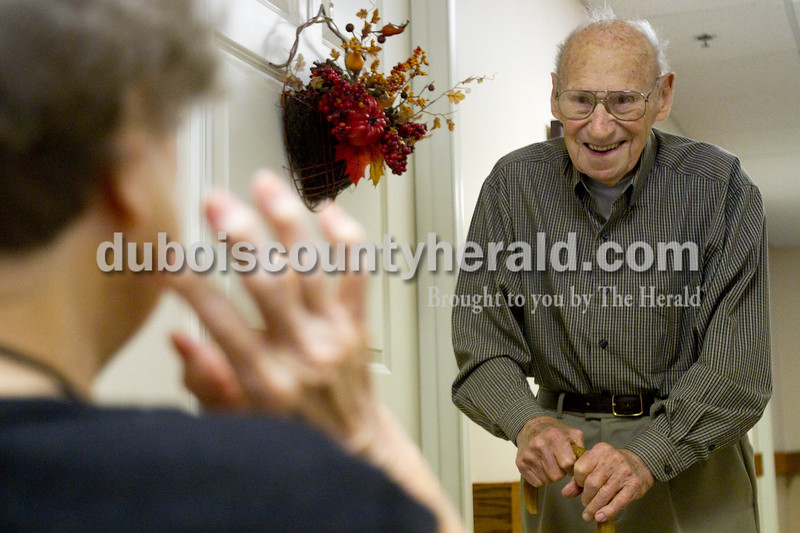 Olivia Corya/The Herald<br /> Brookside Village Senior Living Community resident Charles Bohnert reacted as he ran into his wife Helen Bohnert, also a Brookside resident, who had just received a complementary makeover in celebration the couple's 65th wedding anniversary on Sunday morning. Later that day, friends and family came for a special open house in honor of the occasion. Helen said the star treatment made her feel very special.