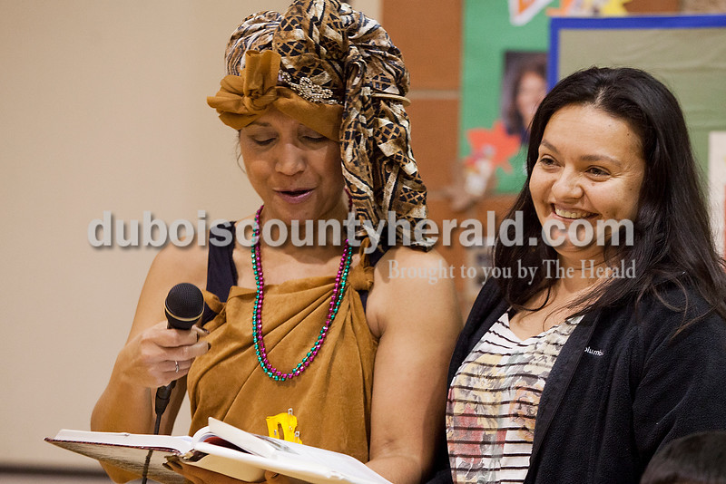 Rachel Mummey/The Herald<br /> Rosa Rivera of Huntingburg, right, smiled to the audience when she finished reading a section of a book aloud with Maura Robinson of Evansville during the Dubois County Family Literacy Night at Huntingburg Elementary School on Tuesday.