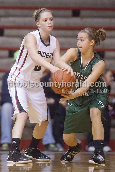 Rachel Mummey/The Herald<br /> Forest Park's Kereston Hochgesang tried passing the ball while being guarded by Southridge's Kabrea Robling during Monday night's game at Memorial Gym in Huntingburg. Southridge won 46-42.