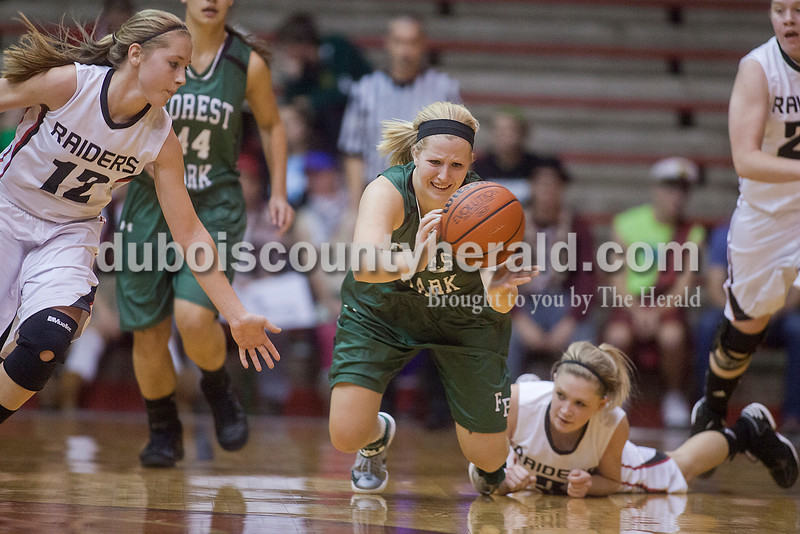 Rachel Mummey/The Herald<br /> Forest Park's Kylie Blessinger dove for the ball with Southridge's Kayley Main, left, close by during Monday night's game at Memorial Gym in Huntingburg. Southridge won 46-42.