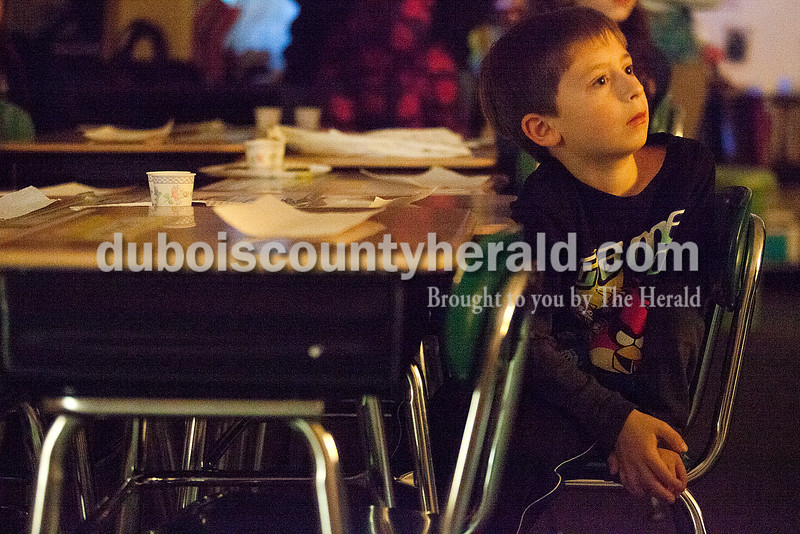 Rachel Mummey/The Herald<br /> Second-grader Brett Stilwell listened intently while being read to during the Dubois County Family Literacy Night at Huntingburg Elementary School on Tuesday.