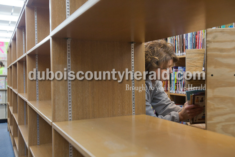 Rachel Mummey/The Herald<br /> Library assistant Lisa McWilliams of Huntinburg, right, packed up some of the library's 118,000 collection items at the Jasper Public Library on Monday. The Jasper Public Library is closed through Dec. 26 to allow the staff to install new shelving, tables and computer workstations, rearrange book sections, and add a new self-checkout station.