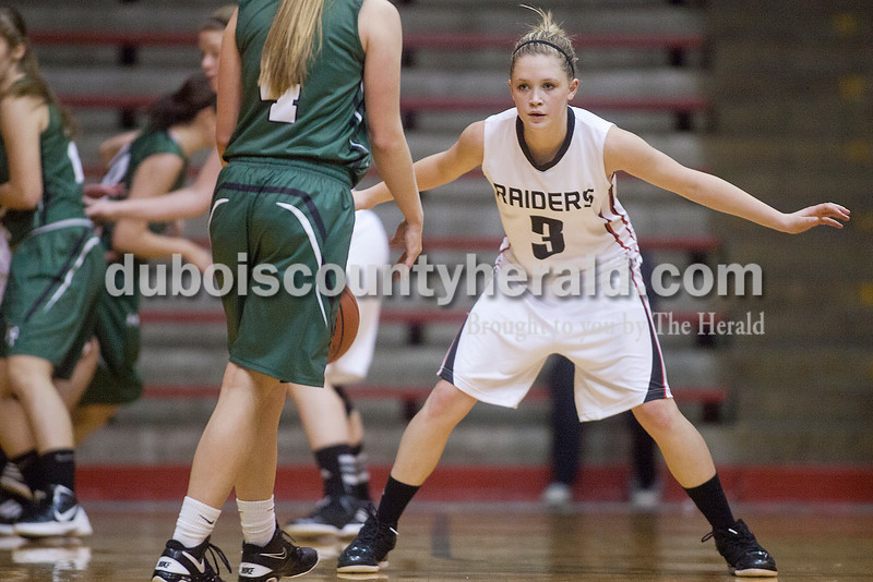 Rachel Mummey/The Herald<br /> Southridge's Kabrea Robling stood guard against Forest Park's Amanda Jacob during Monday night's game at Memorial Gym in Huntingburg. Southridge won 46-42.