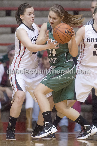 Rachel Mummey/The Herald<br /> Forest Park's Libby Gress pivoted away from Southridge's Leah Eckert   during Monday night's game at Memorial Gym in Huntingburg. Southridge won 46-42.