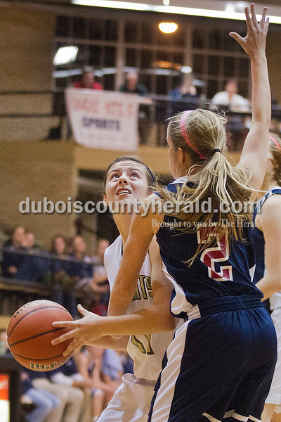 Rachel Mummey/The Herald<br /> Jasper's Emily Jones looked for a shot while being blocked by Heritage Hills' Greer Neff during Monday night's game against Heritage Hills at Cabby O'Neill Gym in Jasper.