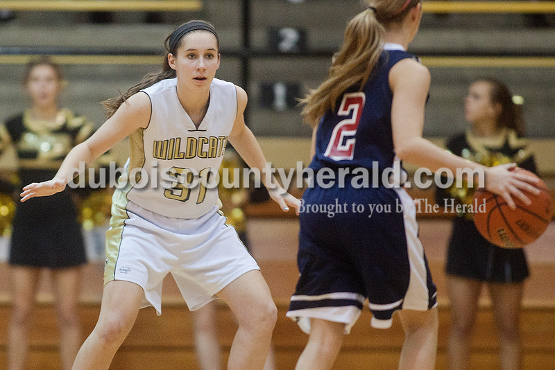Rachel Mummey/The Herald<br /> Jasper's Elisabeth Ahlbrand defended against Heritage Hills' Greer Neff during Monday night's game against Heritage Hills at Cabby O'Neill Gym in Jasper.