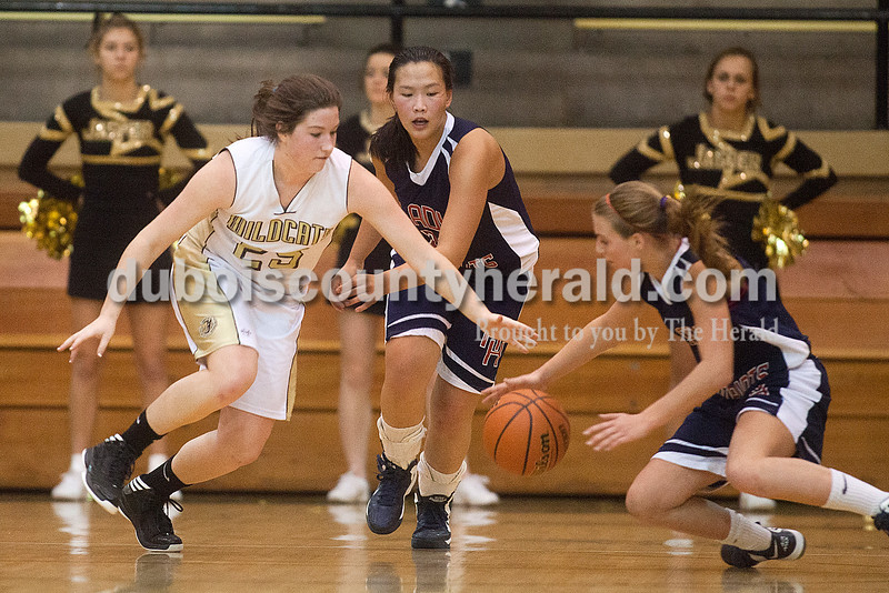 Rachel Mummey/The Herald<br /> Jasper's Brooke Lueken and Heritage Hills' Paige Priest dove for a ball during Monday night's game against Heritage Hills at Cabby O'Neill Gym in Jasper.