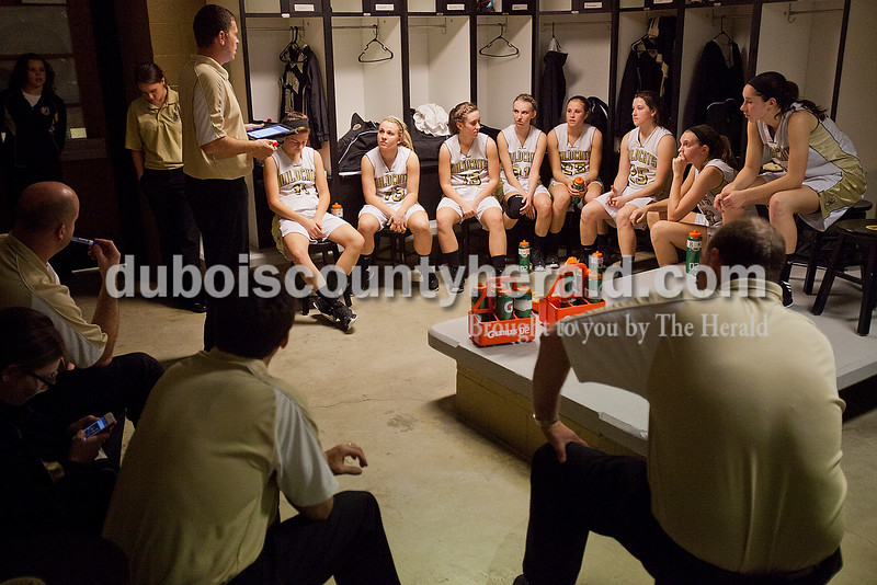 Rachel Mummey/The Herald<br /> Jasper's varsity girls basketball team gathered in the locker room with coaching staff during halftime during Monday night's game against Heritage Hills at Cabby O'Neill Gym in Jasper.