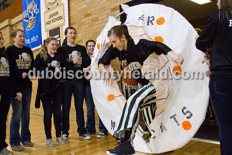 Rachel Mummey/The Herald<br /> Jasper's Allyson Lents broke through a banner at the start of Monday night's game against Heritage Hills at Cabby O'Neill Gym in Jasper.
