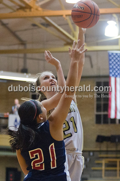 Rachel Mummey/The Herald<br /> Jasper's Maddison Ubelhor went up for a shot while being blocked by Heritage Hills' Hayli Scott during Monday night's game against Heritage Hills at Cabby O'Neill Gym in Jasper.