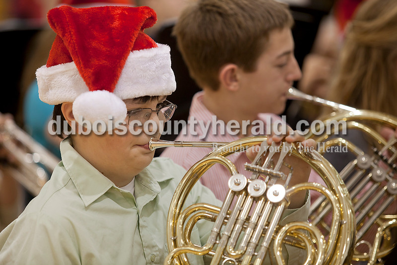 Rachel Mummey/The Herald<br /> Eighth-graders Aidan Kay and Kyle Hollinden played the french horn during the Jasper Middle School's band performance at the American Legion Christmas Party at Jasper Middle School on Sunday.