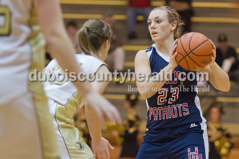 Rachel Mummey/The Herald<br /> Heritage Hills' Abby Fischer looked for an open pass while being guarded by Jasper's Allyson Lents during Monday night's game against Heritage Hills at Cabby O'Neill Gym in Jasper.