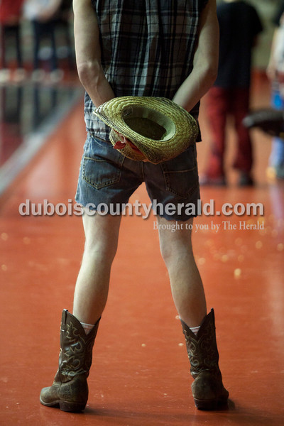 "Olivia Corya/The Herald<br /> Southridge senior Blaize Meyerholtz, dressed in a ""white trash"" costume shared by many in the student section, stood for the national anthem before Saturday night's basketball game against Pike Central at Huntingburg Memorial Gym."