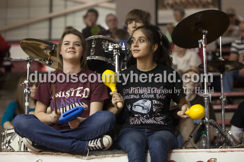 Olivia Corya/The Herald<br /> Southridge pep band members, April Fleck, left, and Emily Calderon played the tempo block and maracas before Saturday night's basketball game against Pike Central at Huntingburg Memorial Gym. Both girls are sophomores.