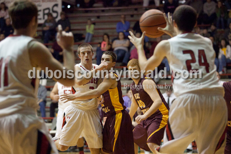 Olivia Corya/The Herald<br /> Southridge's Cody Thompson received a pass from teammate Ben Weber, second to left, during Saturday night's game against Pike Central at Huntingburg Memorial Gym. The Raiders defeated the Chargers 60-36.