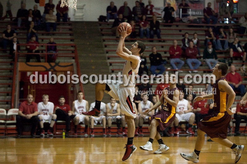 Olivia Corya/The Herald<br /> Southridge's Cody Thompson beat Pike Central to the basket during Saturday night's game at Huntingburg Memorial Gym. The Raiders defeated the Chargers 60-36.