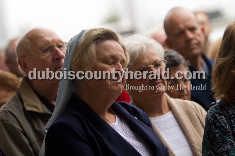 Olivia Corya/The Herald<br /> Little Company of Mary Sister Renee Cunningham of Jasper listened to a speaker during the dedication ceremony of St. Thomas Medical Center, Jasper's newest medical facility, on Saturday. The center includes the orthopedic office of Dr. Daniel Eby, Memorial Hospital's Outpatient Surgery Center and MRI Suite, and a chapel. Charles C. Thompson, Bishop of the Catholic Diocese of Evansville, blessed the building during the ceremony.