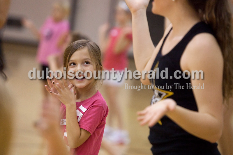 Olivia Corya/The Herald<br /> Addison Willis of Jasper, 6, watched Jasper Dance Team member Annie Ariens of Jasper, 17, demonstrate a routine during a dance clinic at Jasper High School on Saturday. During the clinic, which was a fundraiser for the dance team, participants learned moves to both a hip hop and Christmas song, which they later performed during half time at that night's Jasper versus Bedford basketball game.