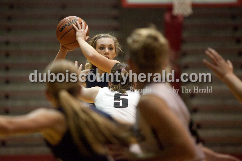 Olivia Corya/The Herald<br /> Heritage Hills' Abby Fischer looked to pass during Tuesday night's game against Southridge at Huntingburg Memorial Gym.