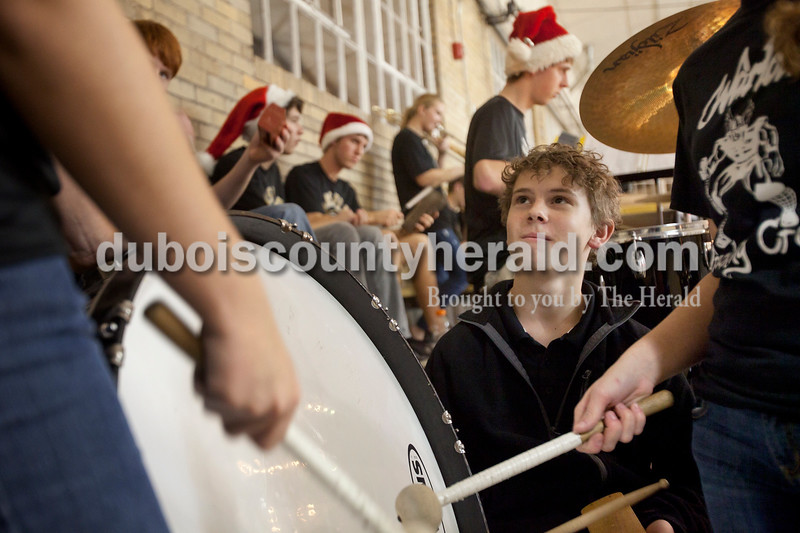 Olivia Corya/The Herald<br /> Jasper freshman Kade Nicholson watched Melanie Stone, freshman, play the base drum as he played the wood blank with the pep band before Saturday night's basketball game against Southridge at Cabby O'Neill Gymnasium in Jasper. The Raiders defeated the Wildcats 58-41.