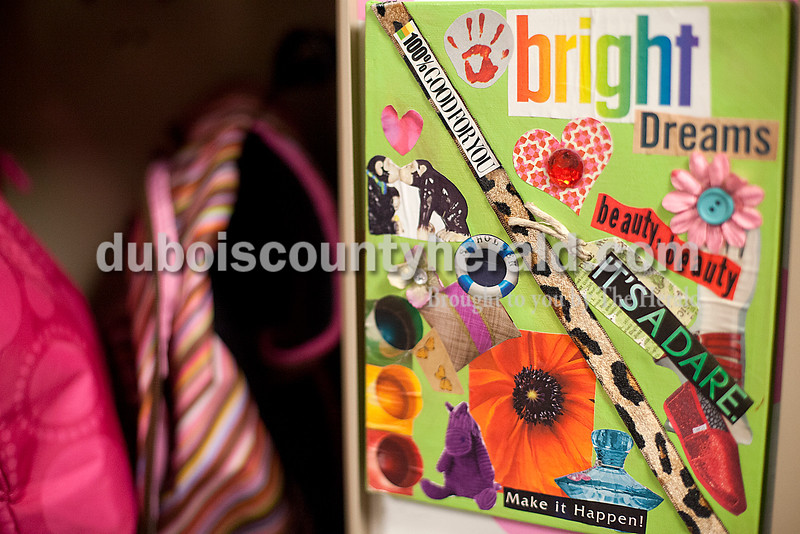 Rachel Mummey/The Herald<br /> A bright collage donned the walls Inside the locker of Jasper Middle School sixth-grader Kendall Russ on Wednesday. Russ decorated her locker with the collage, a mirror and a dry erase board.