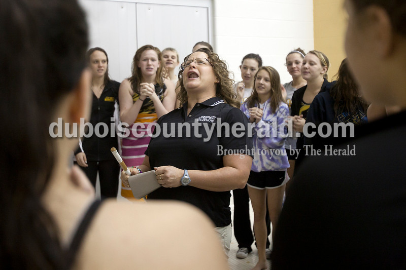 Olivia Corya/The Herald<br /> Jasper's assistant coach Kristin Gutgsell pumped up her team before the Wildcat Invitational at Jasper High School on Saturday afternoon.