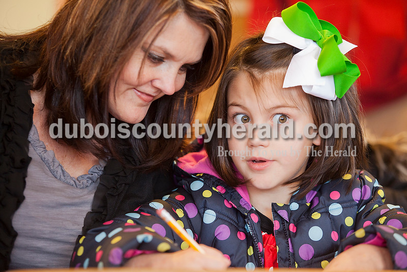 Rachel Mummey/The Herald<br /> Ava McCormick of Rumsey, Kent. thought really hard about what she wanted to write in her letter to Santa with help from her grandma Doris Cartwright, also of Rumsey, Kent., during the grand opening of the  newly restored Original Santa Claus Post Office on Saturday.