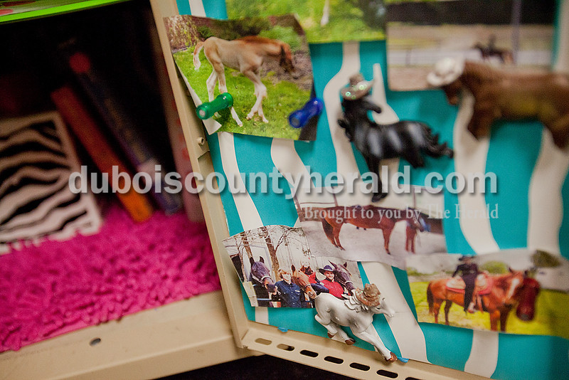 Rachel Mummey/The Herald<br /> Jasper Middle School seventh-grader Caroline Gadlage's locker donned pictures of her horses and other animals on Wednesday. Gadlage decorated her locker with wallpaper, flowers and a mini chandelier.