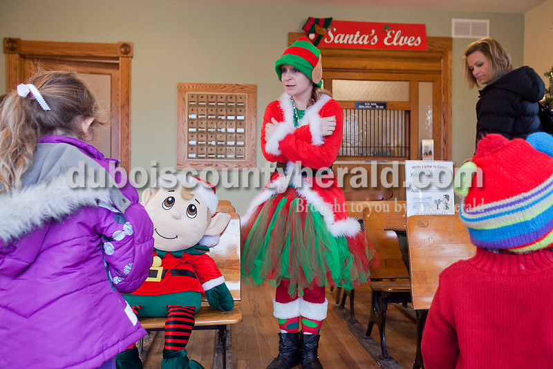 Rachel Mummey/The Herald<br /> Holly the Elf greeted children at the grand opening of the newly remodeled Original Santa Claus Post Office on Saturday.